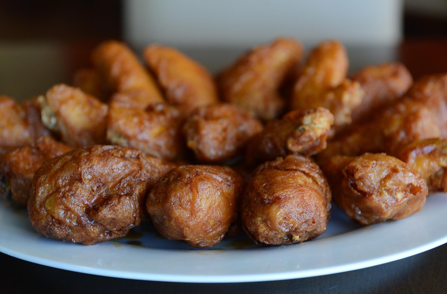 The large combo at Bonchon has spicy and soy-garlic flavors in wings or drumsticks. - SCOTT ELMQUIST