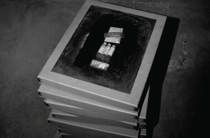 "The limited edition book ""Body of Evidence"" features a portfolio of stories inspired by photographs of evidence boxes. - SCOTT ELMQUISTTHEY WANTED TO BELIEVE THE WORST."