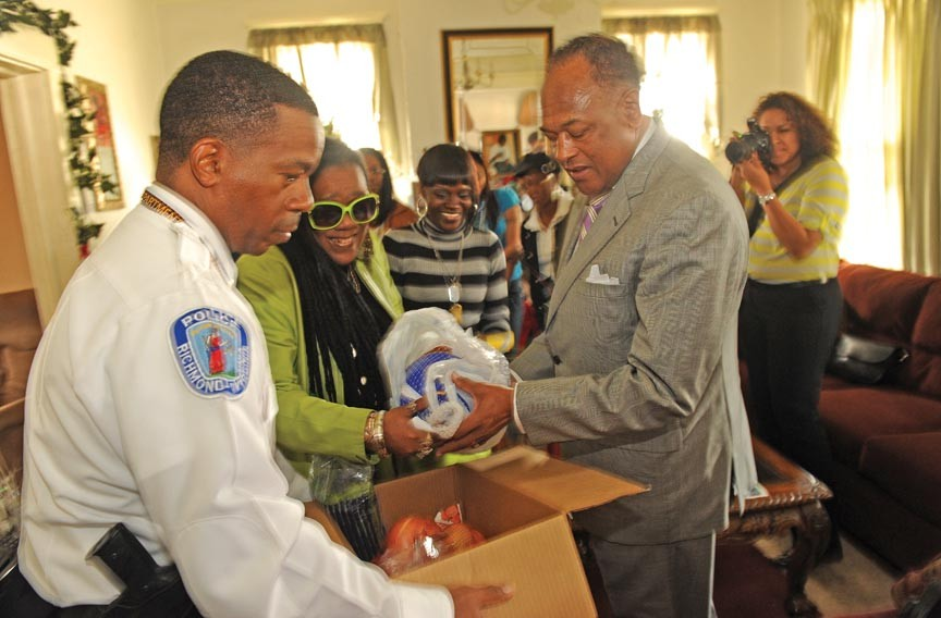 The mayor and Police Chief Bryan Norwood, who have a chilly relationship, deliver Thanksgiving dinner to the family of Lamarco Brown, who was murdered at Hillside Court in September.