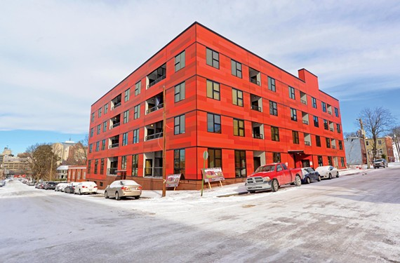 The new apartment complex at North 20th and East Grace streets re-establishes a strong urban street wall and acts as a foil to such Shockoe Valley landmarks as the frame Adam Craig House down the hill.