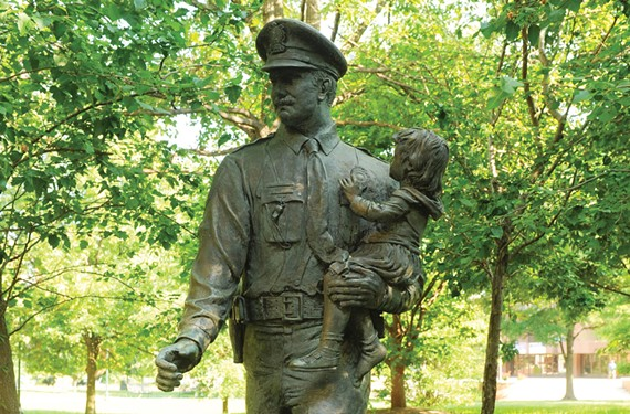"The ""Police Memorial"" by Maria Juliana Kirby-Smith, now outside the Coliseum, soon will be moved to the Police Training Academy on the North Side. - SCOTT ELMQUIST"
