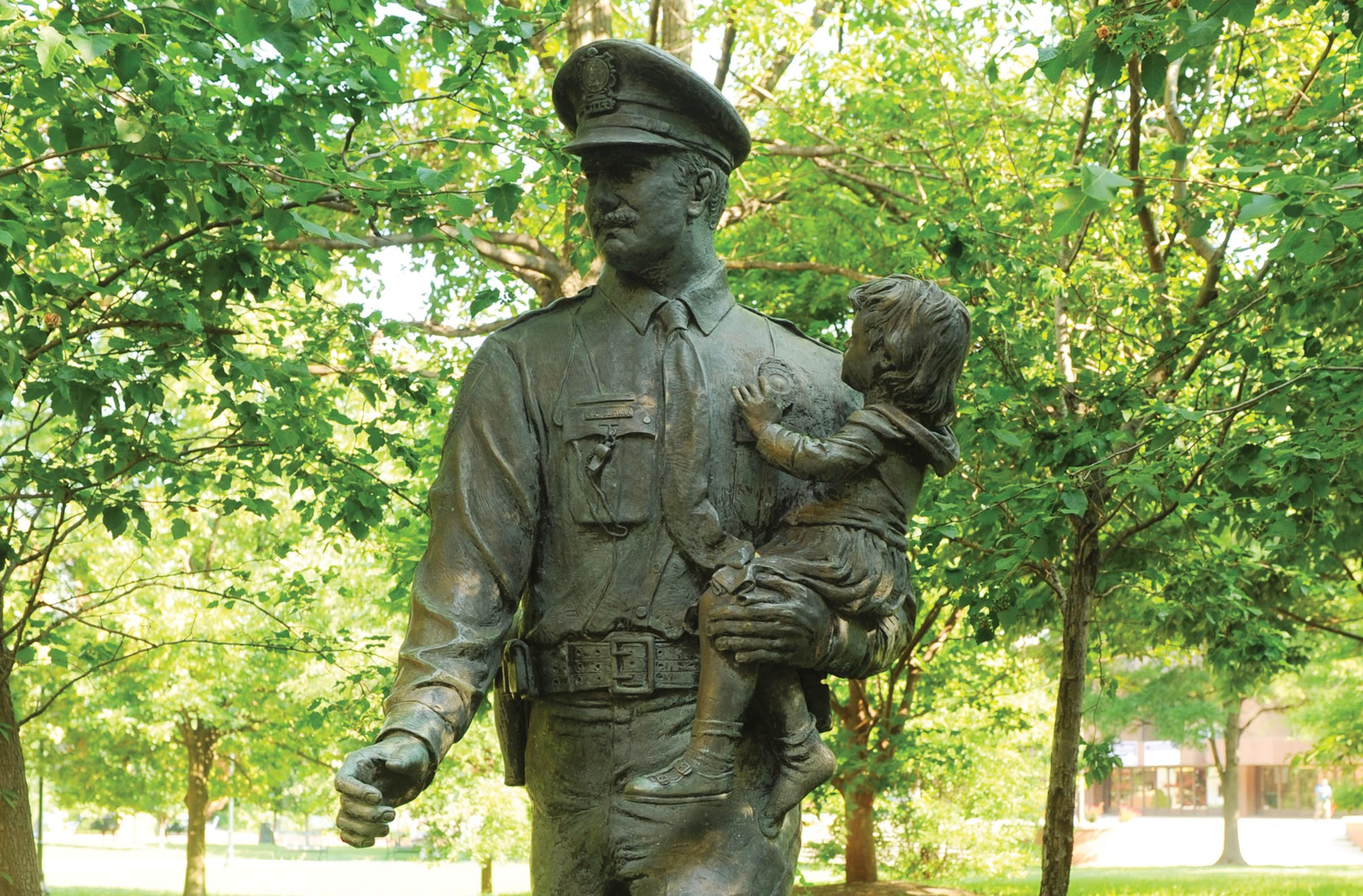 """The """"Police Memorial"""" by Maria Juliana Kirby-Smith, now outside the Coliseum, soon will be moved to the Police Training Academy on the North Side. - SCOTT ELMQUIST"""