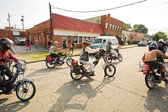 The remaining riders embark for North Carolina from Shawn Lukitsch's moped shop, the Shred Shed East, in Scott's Addition on Tuesday morning.