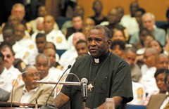 """The Rev. Alonzo Pruitt, chief of chaplains at the jail, eloquently prods council members to vote for the new jail proposal, calling the current facility """"a cancer upon the soul of our city."""" - SCOTT ELMQUIST"""