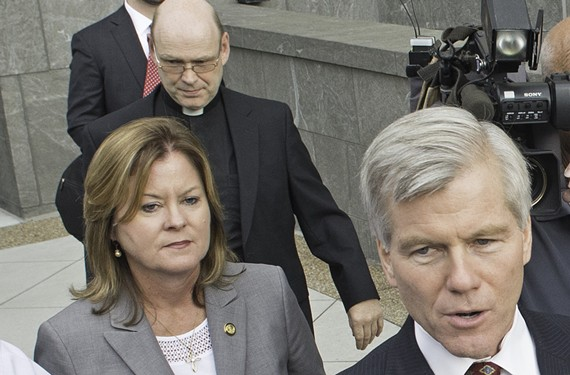The Rev. Wayne Ball follows former Gov. Bob McDonnell from court.