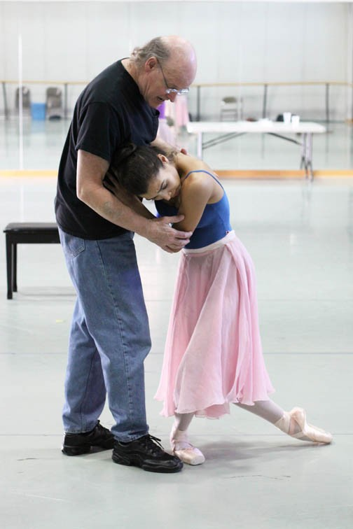 "The Richmond Ballet's Malcolm Burn works with dancer Maggie Small while directing rehearsals for his version of ""Cinderella."""