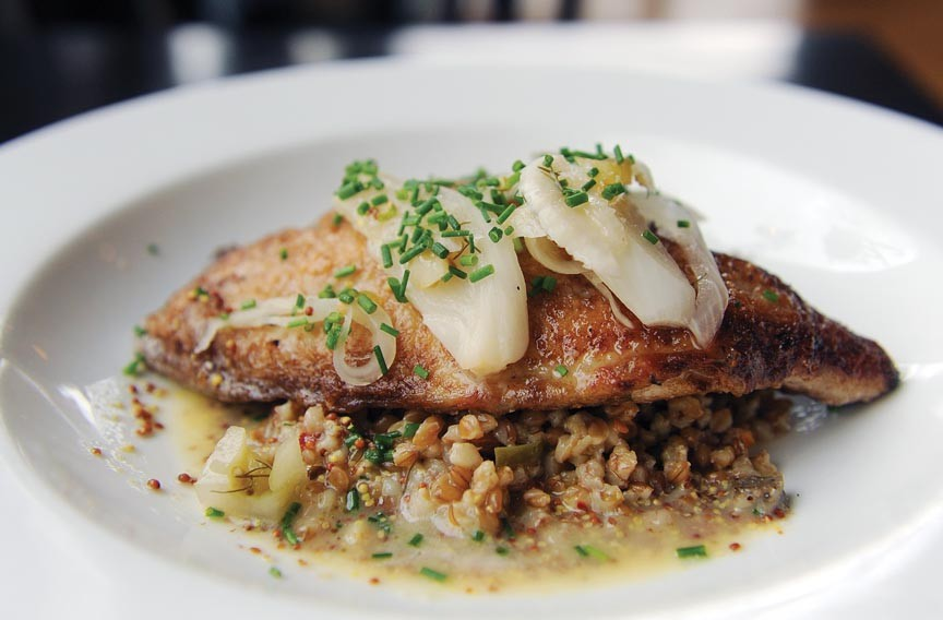The roasted catfish at the Roosevelt comes with South Carolina farro dirty rice and mustard butter.
