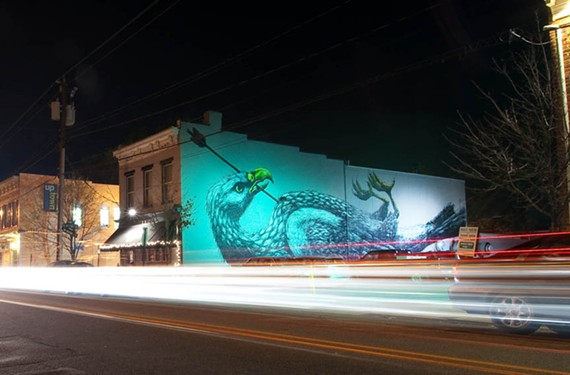 The side of Bellytimber Tavern at 1501 W. Main St. features a mural by ROA, the pseudonym of a graffiti artist from Ghent, Belgium, whose work meditates on social stratification and urban decay. - 1EYE PHOTOGRAPHY