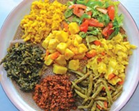 The veggie combo six at Addis has cabbage, potatoes, collards, lentils, yellow split peas and string beans on injera.
