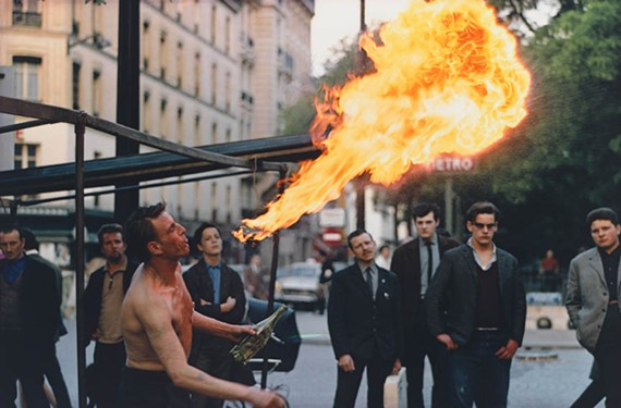 """The Virginia Museum of Fine Arts is housing a stunning exhibit of French street photography that showcases the work of three distinguished photo realists, including American Joel Meyerowitz, who shot """"Street Busker, Paris."""""""