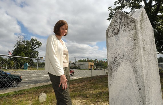 This tiny cemetery, at the corner of Genito and Coalfield roads in Chesterfield County, hemmed in a popular corner for retail traffic. Rachel Lipowicz, who specializes in locating unmarked cemeteries, says developers often must build around them.
