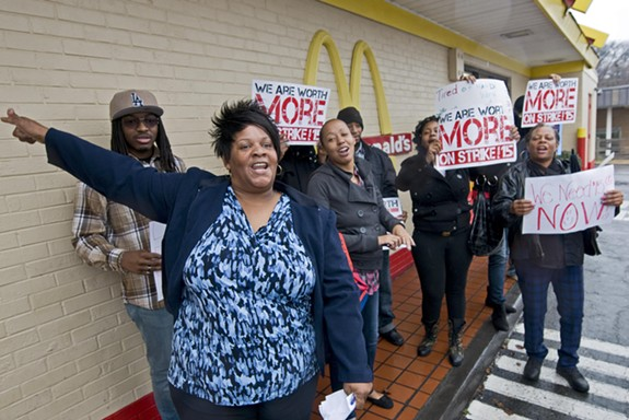 Thomasine Wilson joined others at a protest for higher wages for fast-food workers outside the McDonald's at Hull Street and Commerce Road. - ASH DANIEL