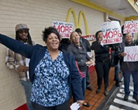 Thomasine Wilson joined others at a protest for higher wages for fast-food workers outside the McDonald's at Hull Street and Commerce Road.