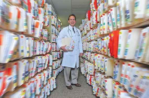 Thousands of patients' paper files, now being digitized, are the lifeblood of Dr. Rick Gergoudis's family practice. - SCOTT ELMQUIST