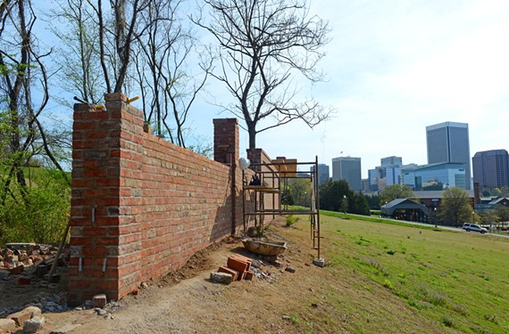 Toppled over by a contractor two years ago, a wall near the Tredegar Green amphitheater is expected to be back up this week.