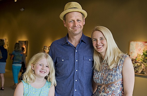 Trask pauses with his daughter, Eleanor, and wife, Kelly, at the opening of his art show at Glave Kocen Gallery. - ASH DANIEL