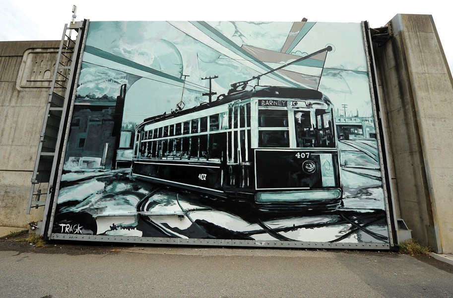 Trask's murals dot the city. He painted this trolley on a wall off the Canal Walk downtown last year. - SCOTT ELMQUIST