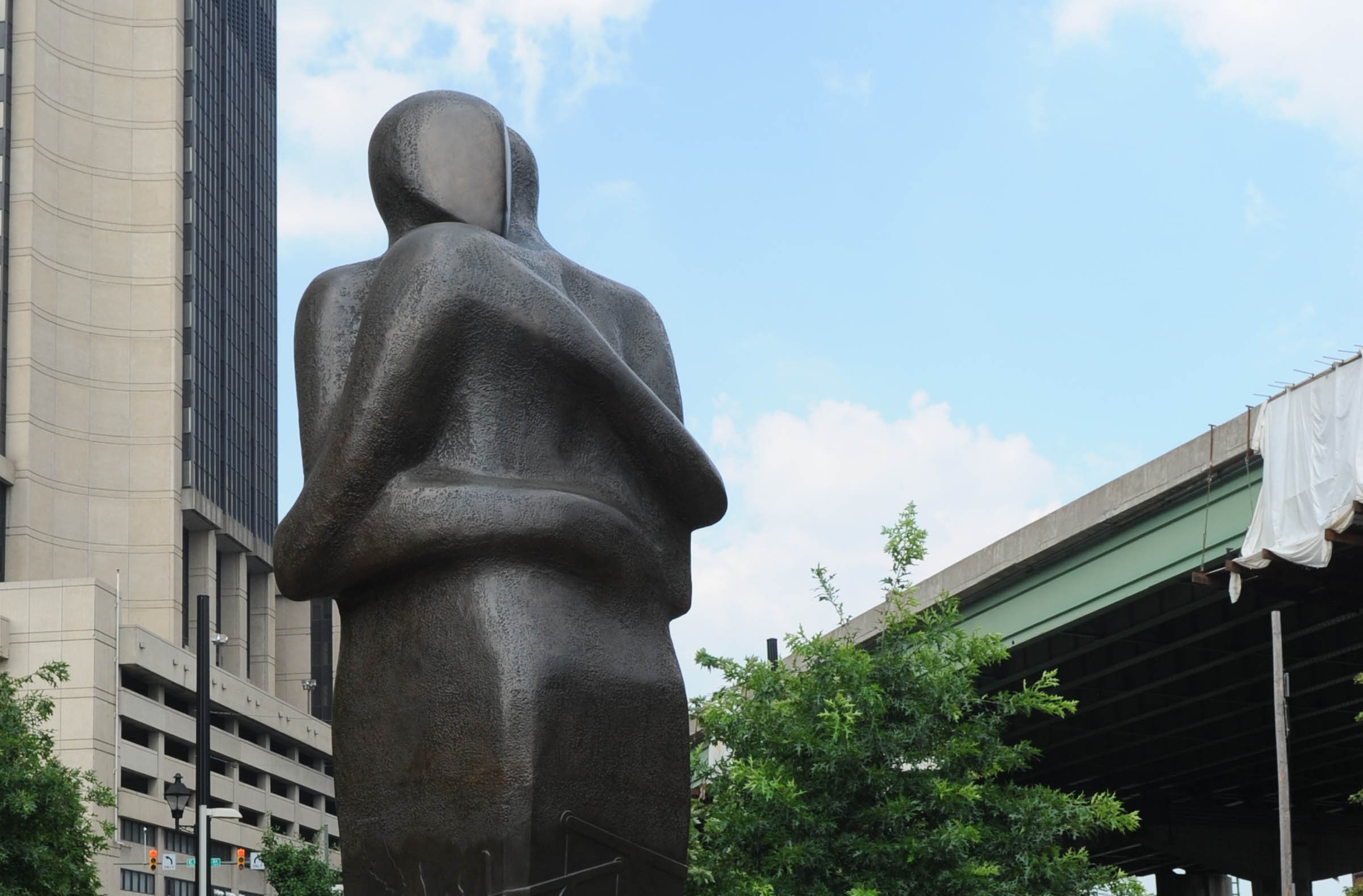 """""""Triangle,"""" the Richmond reconciliation statue by Stephen Broadbent on East Main Street in Shockoe Bottom, marks the legal cessation in 1807 of slave importation, an industry that involved three continents. - SCOTT ELMQUIST"""
