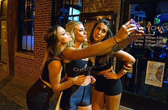Outside of Cha Cha's Cantina, Gabby Kiser, Lauren Johnson and Natalie Silady make the most of available lighting and a proper selfie angle. - SCOTT ELMQUIST