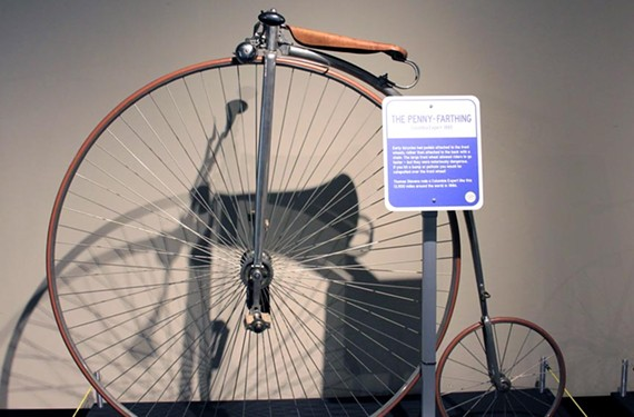 "A high-wheel penny farthing bicycle is on display at the Science Museum of Virginia exhibit ""Bikes: Science on Wheels."" The museum is coordinating its cycling exhibition with the Valentine's ""In Gear: Richmond Cycles"" exhibit and a lecture at the Branch Museum of Architecture and Design."