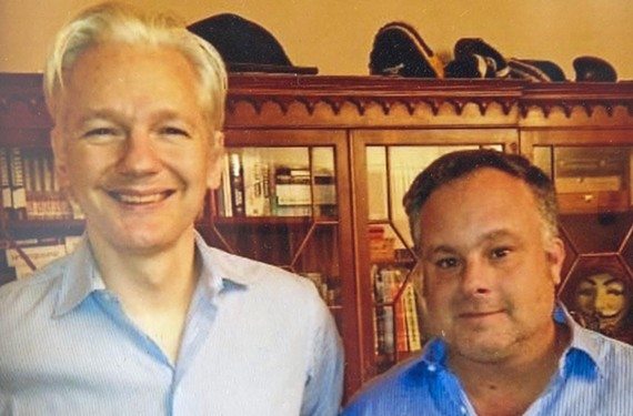 WikiLeaks editor-in-chief, Julian Assange  appears with Trevor FitzGibbon in a photo. Assange is receiving political asylum at the Ecuadorian Embassy in London and fears if he leaves he will be arrested and extradited to the United States.