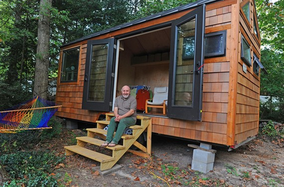 "Partly because of environmental concerns, Derryl Cocks lives in a local tiny house community where multiple people share a kitchen. ""I'm from New Zealand and my family did a lot of camping with a caravan,"" he says. ""So I did a lot of living in small spaces."" - SCOTT ELMQUIST"
