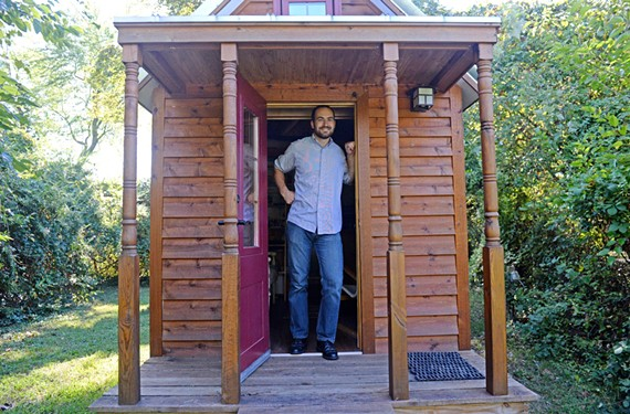 Kevin Riedel built his tiny house for about $20,000 after graduating from Virginia Tech. It sits on property of a larger house he owns and is outfitted simply. - SCOTT ELMQUIST