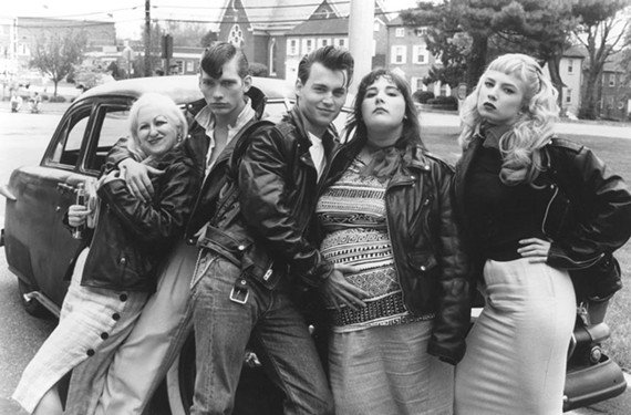 """The rockabilly musical """"Cry-Baby"""" was actor Johnny Depp's first shot as a leading man on the big screen. Here Depp caresses the belly of Ricki Lake as former porn star Traci Lords, at right, looks on; to the left are Darren Burrows and Kim McGuire as Mona """"Hatchet-Face"""" Malnorowski."""
