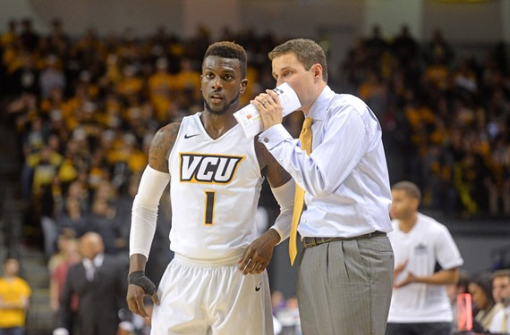 Point guard JeQuan Lewis gets advice from Wade, who's known for his passionate intensity during games and for his scientific approach to basketball off the court. - SCOTT ELMQUIST