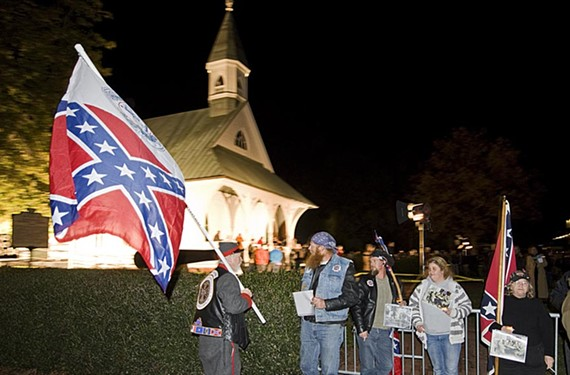 Protesters object to using the Confederate Memorial Chapel for an artistic exhibit during InLight Richmond in November. Organizers said they used it respectfully. - ASH DANIEL