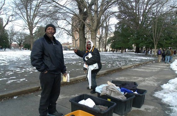 His family says Ward, shown here in the white hood, died of hypothermia before police found his body outside of the Daily Planet on Grace Street. - GOFUNDME.COM