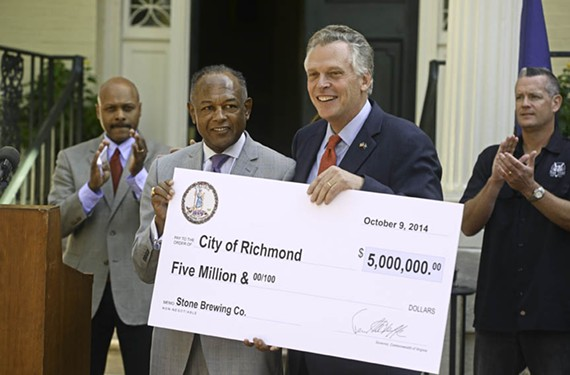 At the Executive Mansion with Gov. Terry McAuliffe, Jones receives a check for $5 million in state incentives for Stone Brewing Co. in October 2014. The brewery, which officially opens March 2, was widely celebrated as an economic-development booster and job creator. - SCOTT ELMQUIST