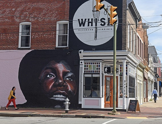 The famous Nina Simone mural, updated, on the side of Whisk Bakery.