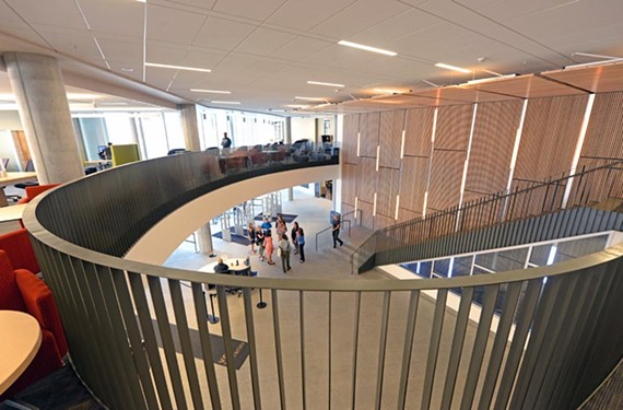 A broad staircase links the entrance lobby with flexible second-floor study areas. - SCOTT ELMQUIST