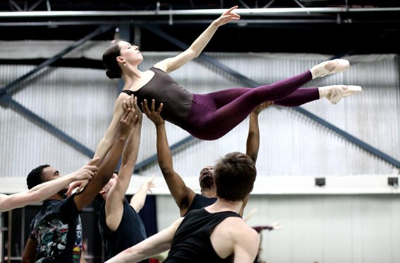 Dancer Sabrina Holland is lifted aloft by fellow Richmond Ballet dancers. - SARAH FERGUSON