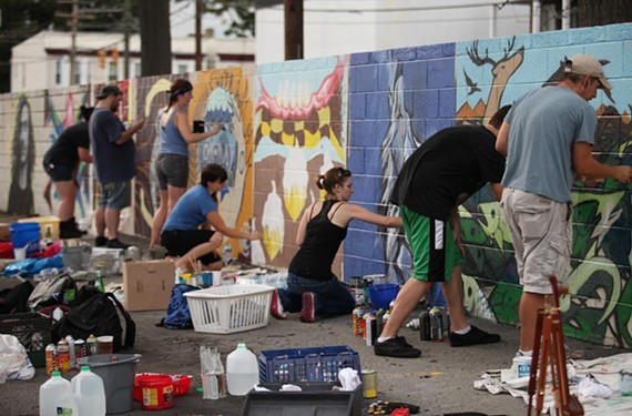 Artists work away at the former GRTC bus depot on Cary St, which has been sold, during the last RVA Street Art Festival.