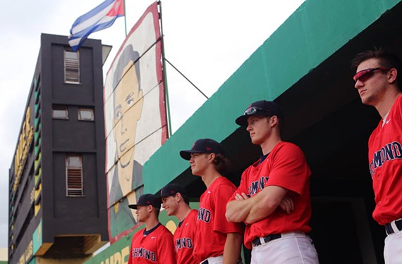 During their trip to Cuba, University of Richmond baseball players Zach Grossfeld, Zach Moore, Robbie Baker and Pete Bovenzi stay loose in the bullpen midgame against Pinar del Rio. - UNIVERSITY OF RICHMOND ATHLETICS