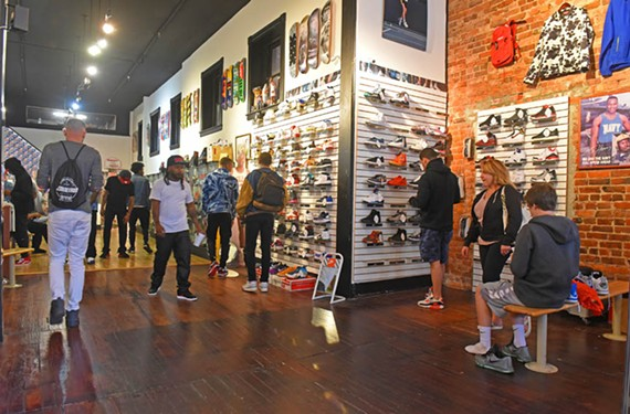 Customers browse Round Two, a sneaker shop at 202 W. Broad St. The business took off after opening three years ago and serves a wide-ranging clientele. - SCOTT ELMQUIST