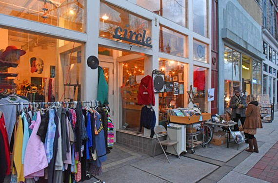 The sidewalk in front of Circle Thrift at 7 W. Broad St. is packed with wares on a recent First Friday. Owner Chris Maloney says sales have increased because of foot traffic from the event, but construction of the imminent bus rapid transit project could keep customers away. - SCOTT ELMQUIST