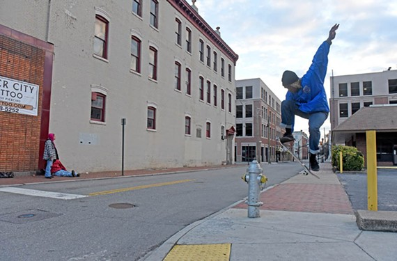 A skateboarder practices tricks in front of the former New York Fried Chicken & Biscuit on West Broad Street. The shuttered restaurant is close to where Virginia Commonwealth University plans to open its Institute for Contemporary Art, which will serve as a gateway to the Monroe Park Campus. - SCOTT ELMQUIST