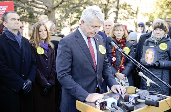 Herring speaks at a Jan. 13 vigil for gun violence victims. Barbara Parker, at right, the mother of slain reporter Alison Parker, holds her late daughter's picture. - ASH DANIEL