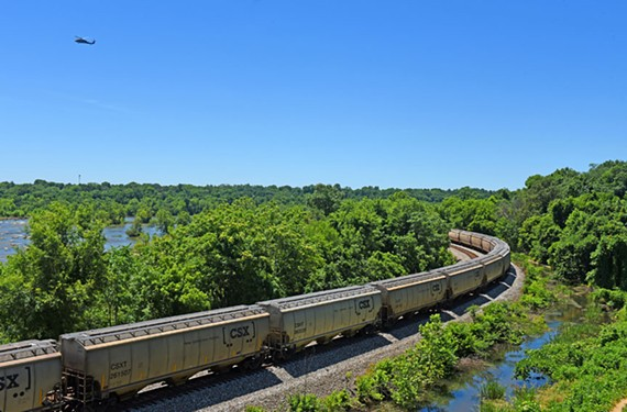 A modern-day diesel train hauls grain through the city. - SCOTT ELMQUIST