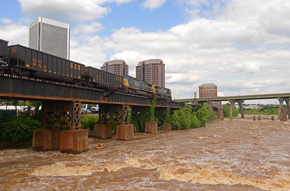 A modern-day diesel train carries coal above the churning James River. - SCOTT ELMQUIST