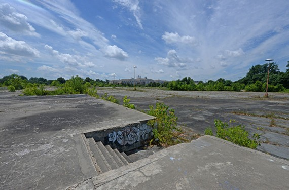 Slabs of concrete are all that remain of Azalea Bowl on Brook Road. In the distance is the Westminster Canterbury Richmond retirement community. - SCOTT ELMQUIST