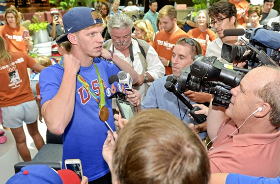 Richmond-area reporters zoom in on Haas while he gets a hero's welcome after his return from Rio at the Richmond International Airport on Aug. 15. - ASH DANIEL