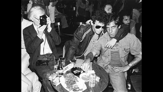 "Andy Warhol, Lou Reed and Danny Fields in a still from ""Danny Says."""