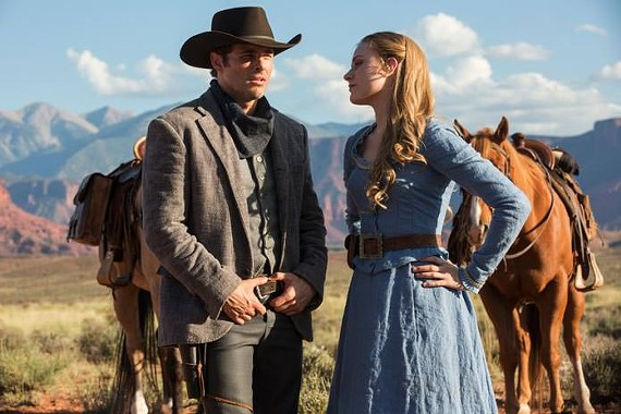 "The farmer's daughter, played by Evan Rachel Wood, and her friendly, mysterious stranger in HBO's ""Westworld."""