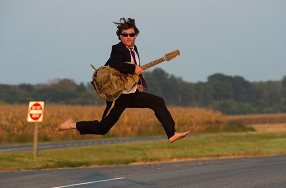 Keller Williams and his guitar make a dash for it. - C. TAYLOR CROTHERS