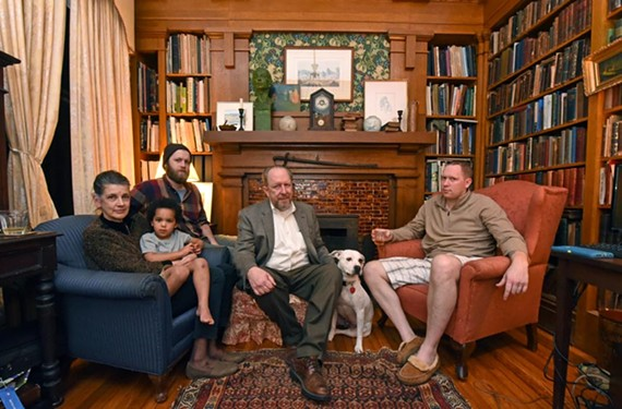 Members of three of the six generations of Worshams to live at 3601 Brook Road pose in the library with dog Madison. Charlotte holds grandson John Lee with husband Gibson and sons Braxton, left, and Charles. - SCOTT ELMQUIST