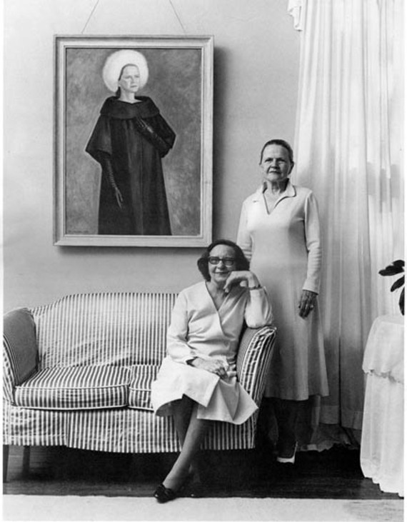 "Sarah Worsham Landrum posed in 1982 in the living room beside her portrait, ""White Fox Bonnet,"" which her seated sister, Bell Worsham, painted. - JOHN HENLY/CLUE MAGAZINE"